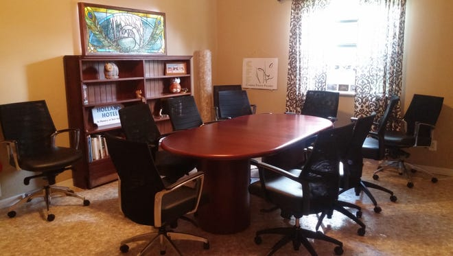 Volunteers and staff pooled their talents to transform the conference room from drab to delightful. The result is a much cheerier space, conducive to brainstorming.