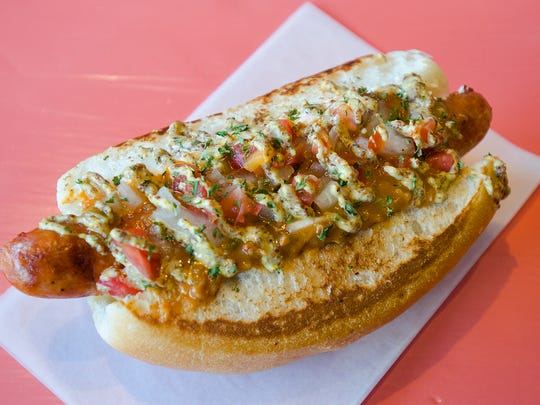 This crawfish etouffee hot dog is one of many items you'll find at Dat Dog's food truck during Festival International.
