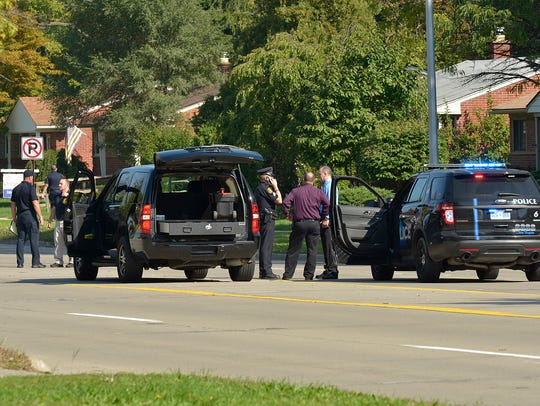 Livonia Police searching Merriman Road for shell casings.