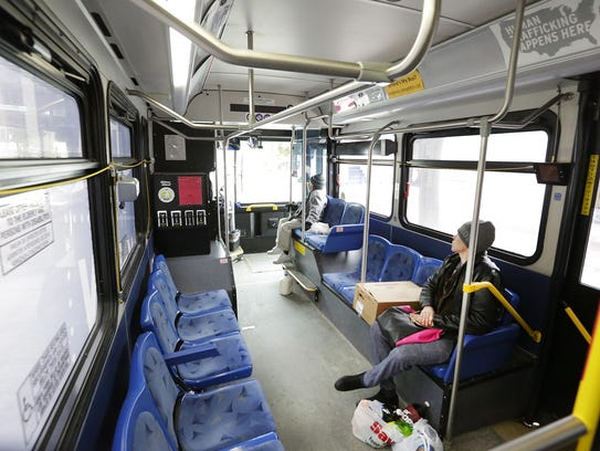Two people ride a City of Fond du Lac bus on Dec. 29.
