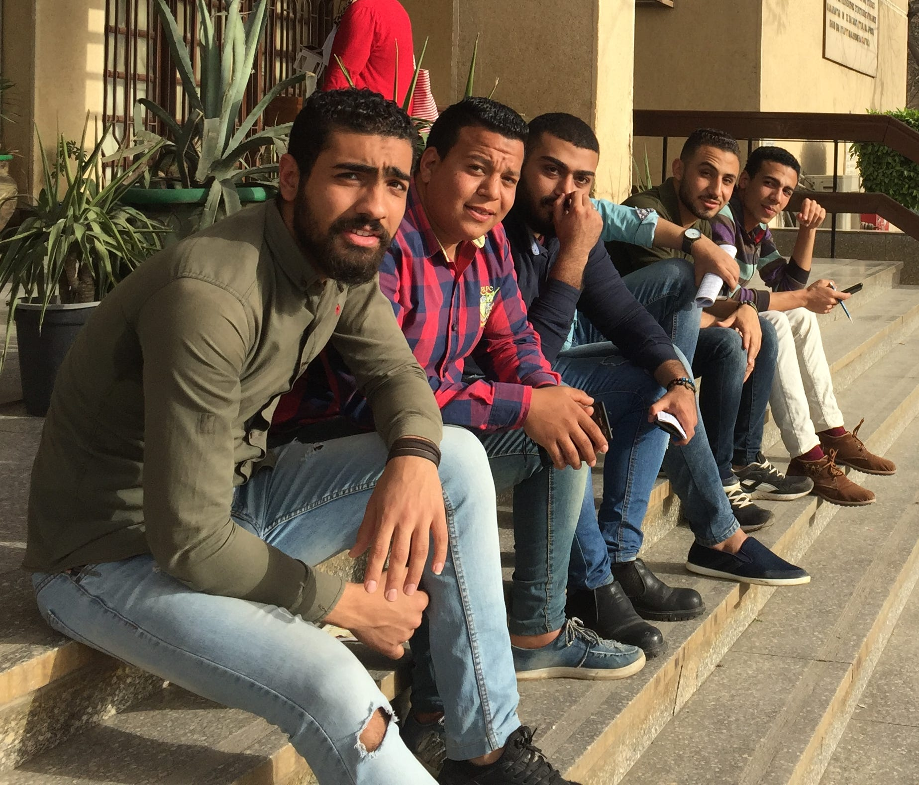 Cairo University undergraduates take a break outside the campus examination hall. All student and faculty political activities have been banned at Egypt's 43 public and private universities since the 2013 ascension of Abdel Fatah El-Sissi to power.