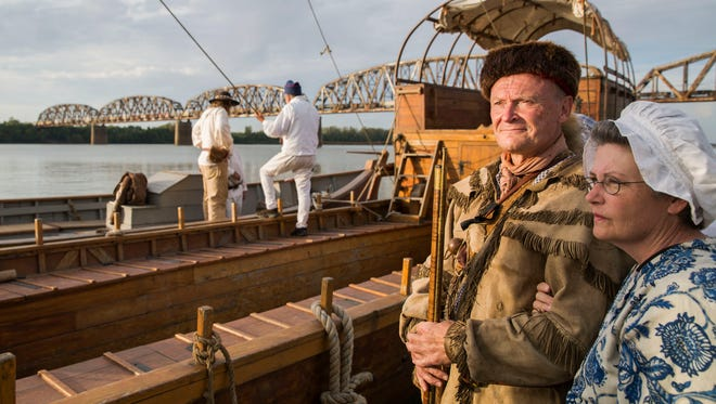 Ron Strominger and his wife, Joan Strominger stand next to the ships after they arrive in Henderson, Ky., during the reenactment of the Lewis and Clark expedition on Monday evening.