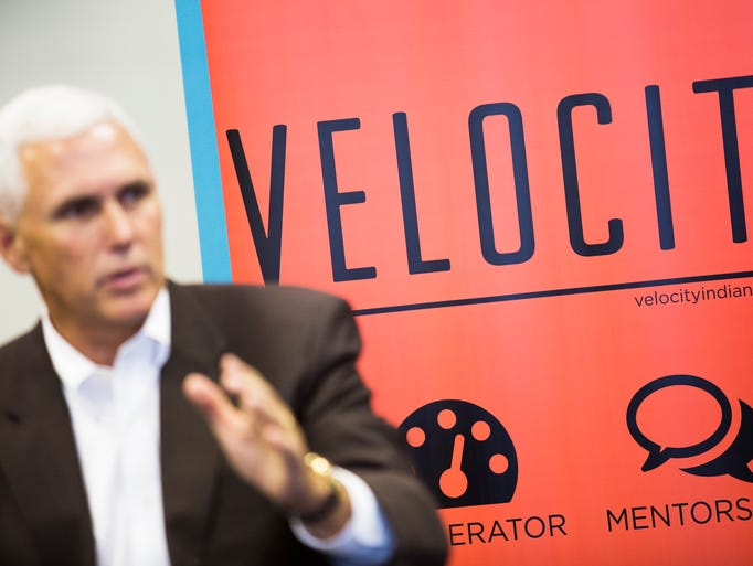 Indiana Governor Mike Pence talks with entrepreneurs and members of the business community while visiting Velocity, a business accelerator and co-working space in Jeffersonville, Indiana.