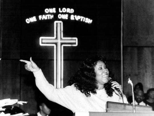 Aretha Franklin sings during a peace vigil Sunday night at New Bethel Baptist Church, Detroit.  Also present was Mayor Coleman Young in January 1981.