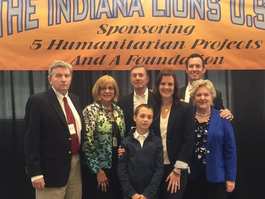 Family honor The Indiana Lions State Convention was held recently and descendants of W.P. Woods, MD, the first International President of Lions Clubs International, were in attendance.  Dr. Woods was a practicing physician in Evansville for more than 60 years. From left are grandson William Deems, Virginia Deems, David Tittle, great-great-grandson Jackson Bowden, great-granddaughter Maggie Tittle Bowden, great-grandson Scott Tittle and granddaughter Judy Deems Nussbaum.