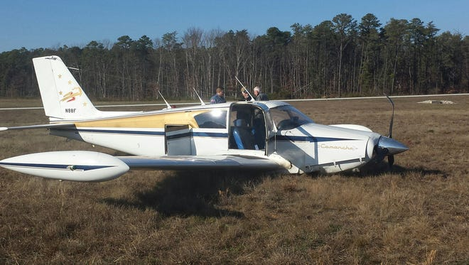 A single-engine Piper Comanche plane made an emergency landing at Millville Municipal Airport after apparently losing power shortly after takeoff Friday. The pilot suffered only minor injuries and a passenger was unhurt.