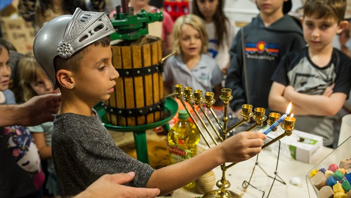 Kids learn how olive oil is handpressed and then light
