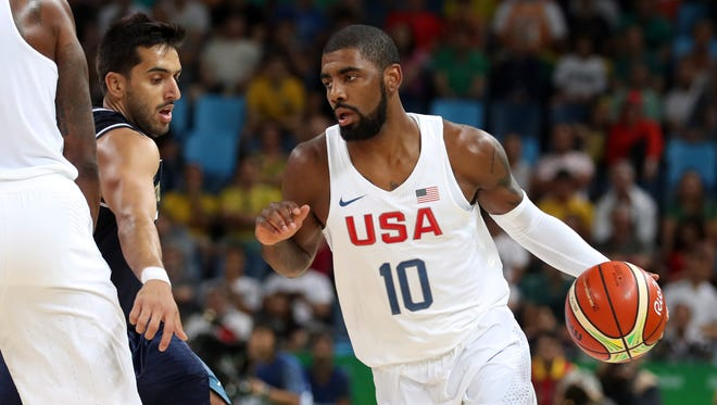 USA guard Kyrie Irving (10) drives to the basket against Argentina point guard Facundo Campazzo (7) during the men's basketball quarterfinals in the Rio 2016 Summer Olympic Games at Carioca Arena 1.