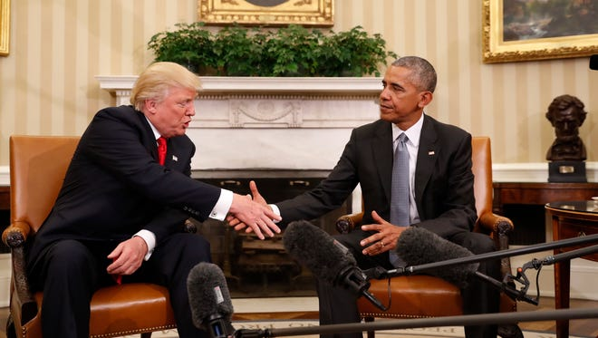 Then-president Obama shakes hands with then-president-elect Donald Trump in the Oval Office on Nov. 10, 2016.