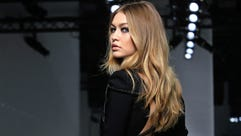 Model Gigi Hadid wears a creation as part of Versace's