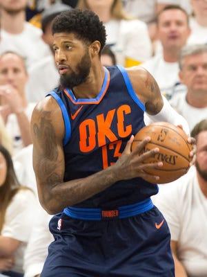 Oklahoma City Thunder forward Paul George controls the ball.