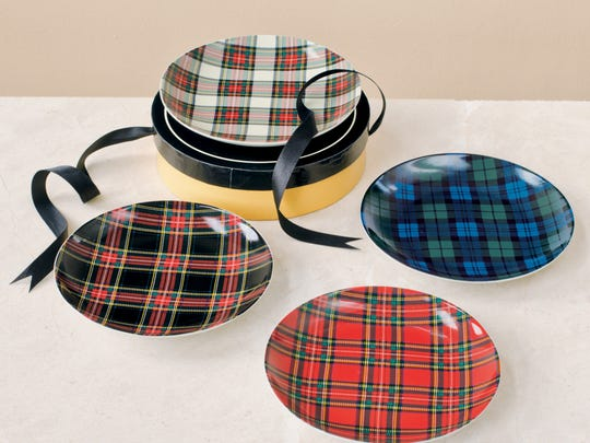 This photo provided by Pendleton-USA shows Tartan plates that take the Scottish décor trend to the table. The iconic pattern is showing up on furnishings and accessories for this fall as Scotland joins England as an inspiration for designers. (AP Photo/Pendleton-USA)