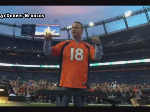 Peyton manning directs the colorado symphony in rocky top denver