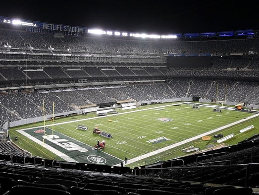 The operations crew at MetLife Stadium changes the