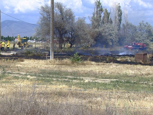 Farmer mowing weeds sparks Meridian grass fire