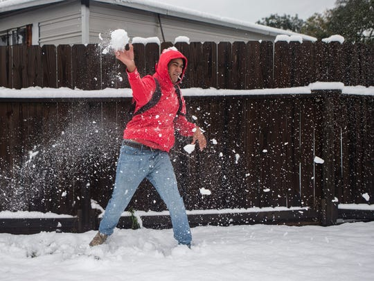 Michael Vasquiz  throws a snowball at a fellow student  outside Mary Carroll High School in Corpus Christi on Friday, Dec. 8, 2017.