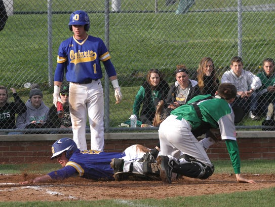 Ontario's Nick Arnold slides into Clear Fork's AJ Blubaugh