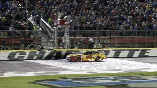Joey Logano crosses the finish line to win the NASCAR All-Star auto race at Charlotte Motor Speedway in Concord, N.C., Saturday.