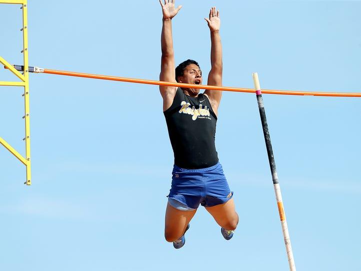 Bremerton High School pole vaulter Jesse Smith reacts
