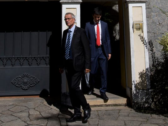 French investigative magistrate Renaud van Ruymbeke leaves the residence of Carlos Nuzman, president of the Brazilian Olympic committee, in Rio de Janeiro, Brazil, Tuesday, Sept. 5, 2017. Federal police searched Nuzman's house Tuesday morning. French and Brazilian authorities have been working on a corruption investigation involving bribery surrounding the awarding of the 2016 Rio Games and the 2020 Tokyo Games. (AP Photo/Silvia Izquierdo)(AP Photo/Silvia Izquierdo)