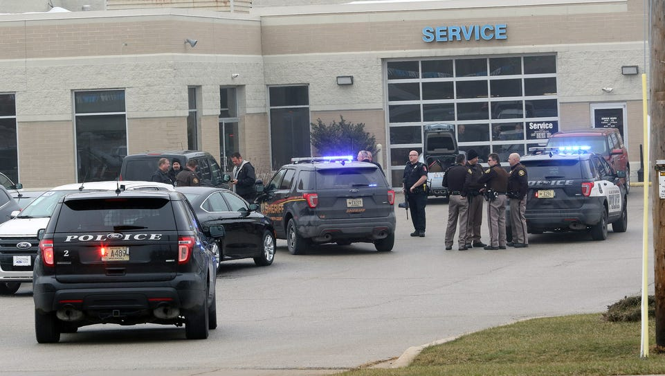 Multiple law-enforcement vehicles and officers were