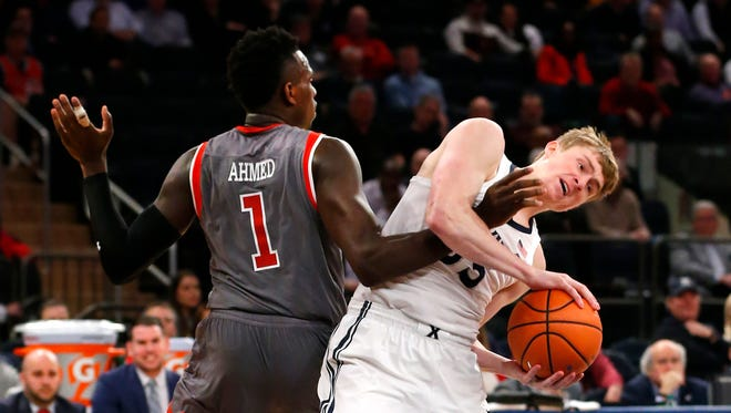 March 8: St. John's guard Bashir Ahmed (1) defends against Xavier guard J.P. Macura (55) during first half of their Big East tournament at Madison Square Garden in New York.
