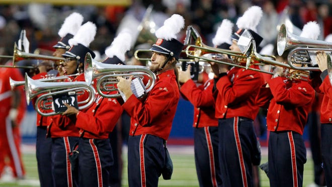 """The marching band at Ole Miss, shown here in 2009, is being asked to look away from """"Dixie,"""" as the old song goes. University of Mississippi officials want the school's band to stop playing all variations of the song """"Dixie"""" before football games. Athletics Director Ross Bjork says he asked band to create a new pre-game show that """"is more inclusive for all fans."""""""