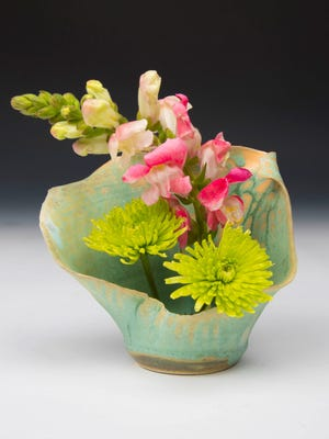 Porcelain ikebana by Chad Luberger, whose work is featured in a special art show April 14 at Plum Bottom Pottery & Gallery.