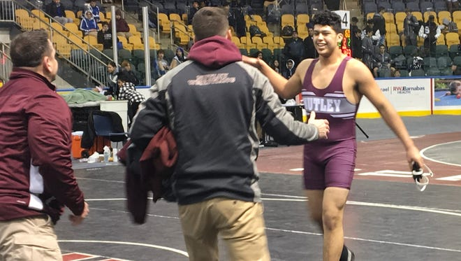 Nutley's Justin Luna (right) is all smiles with coaches after reaching the county semifinals.