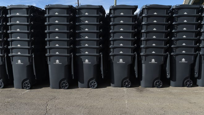 Workers with L&J Distributors put together over 56,000 trash cans, which will be distributed across the city of Knoxville.