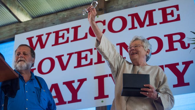 Governor Kay Ivey is presented the Key to the City by Mayor Phil Creswell as the city of Camden and Wilcox County celebrate Kay Ivey day at The Shed outside of Camden, Ala. on Friday evening June 30, 2017.