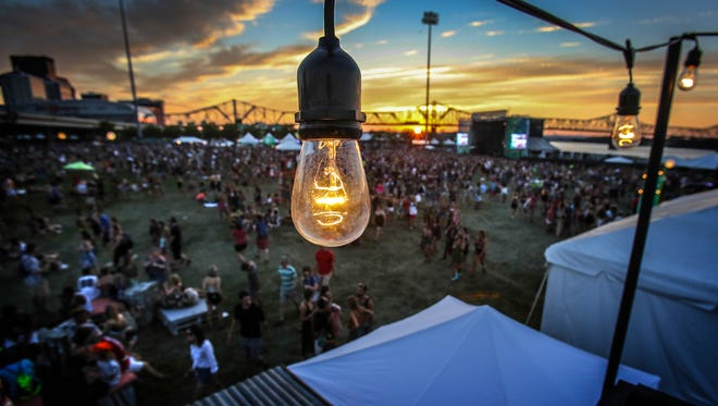 Forecastle slides from day into night on the Great Lawn.July 14, 2017