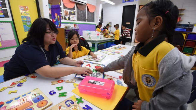 Kindergarten teacher Pearl Hamada interacts with her students at Chief Brodie Memorial Elementary School during their first day back to school in Tamuning on Thursday, Aug. 17, 2017.