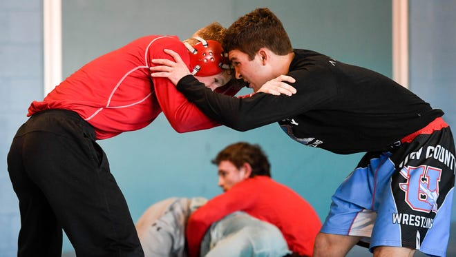 Payne Carr (left) and Saul Ervin grapple during a afternoon practice session as the Union County High School Wrestling Team prepares for the Kentucky State Wrestling Final in Lexington Tuesday, February 13, 2018.