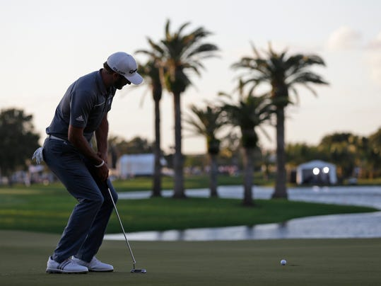 Dustin Johnson watches his putt on the 18th green during the second round of the Cadillac Championship golf tournament Friday, March 7, 2014, in Doral, Fla. Johnson bogeyed the hole. (AP Photo/Wilfredo Lee)