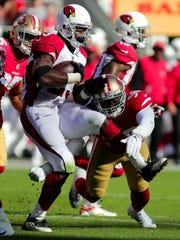 Cardinals running back Adrian Peterson carried the