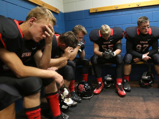 SPASH players collect themselves in the locker room before the game between Stevens Point and Wisconsin Rapids at the rivalry Ol' River Jug game, September 23, 2016.