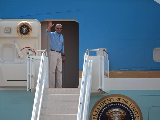 President Barack Obama waves as he departs from Palm Springs International Airport on June 21, 2015.