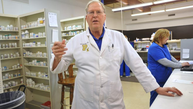 Pharmacist Dick Dovidas, explains how they handle sales of pseudoephedrine at the Blue River Pharmacy in Shelbyville, Indiana, Tuesday January 29, 2013.