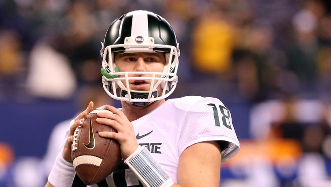 Michigan State  quarterback Connor Cook warms up before the Big Ten Conference football championship game against the Iowa Hawkeyes at Lucas Oil Stadium.