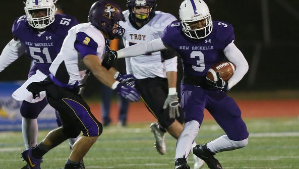 Troy defeated New Rochelle 20-14 in the state Class