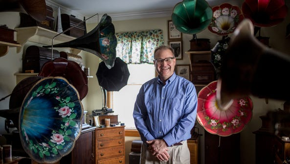 Dave Dazer pictured with his collection of phonographs