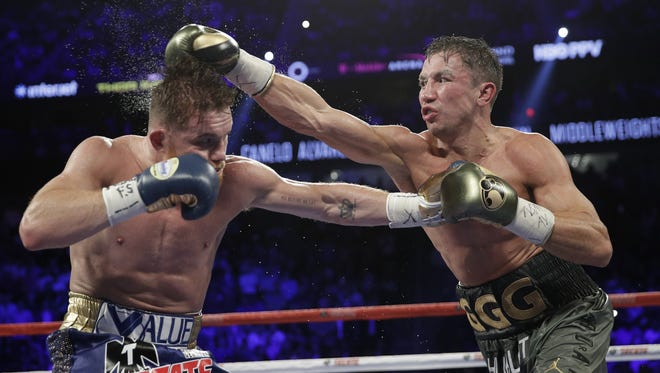 Gennady Golovkin, right, connects with a right to Canelo Alvarez during their first bout on Sept. 16, 2017. The fight ended in a draw. The two will meet again May 5 at the T-Mobile Arena in Las Vegas.