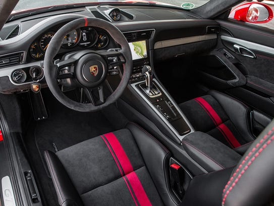 Inside, the Porsche 911 GT3 is cloaked in leather and faux-suede Alcantara, the better to grip you as the car pulls massive Gs in cornering, acceleration and braking.