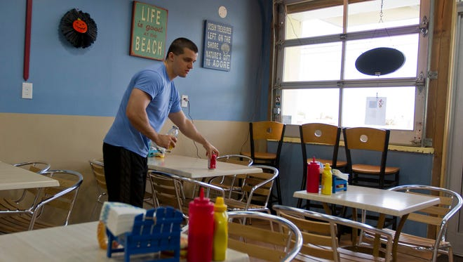 Antonio Murray, owner of Beach Burgers & Grille in Sea Bright, N.J., works in his restaurant which he recently opened after the previous owner decided not to return after Sandy.