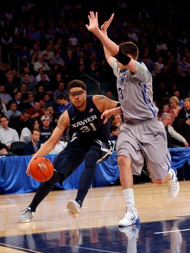 Xavier Musketeers forward Isaiah Philmore (31) drives to the basket against Creighton Bluejays forward Doug McDermott (3).