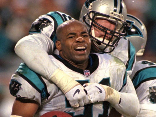 Carolina Panthers linebacker Sam Mills celebrating with teammate Matt Elliott after his interception in the final moments of the Panthers' 26-17 win over the Dallas Cowboys in a 1997 playoff game.