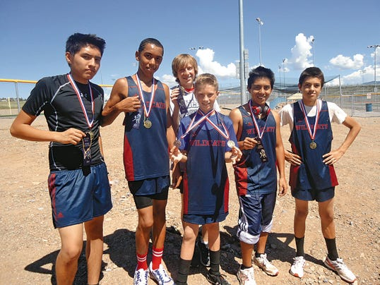 Courtesy Photo   The Deming High junior varsity runners captured first place as a team at the Silver High Invitational Meet in Silver City. From left are, Jonathan Reyes, 9th; Usaamah-Bn Sekka, 7th; Justin Maes (back), 6th; Nick Yacone, 5th; Gabriel Mesta, 10th;   and Rhavi Giovannetti, 12th.