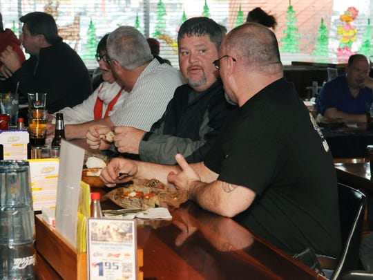 Tom LeFever, left, and Scott McCreary have lunch at Roosters in Lancaster.