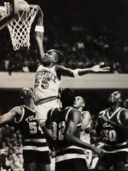 Louisville's Billy Thompson dunks over Tulane defenders in UofL's 52-51 victory. 1/10/1985.